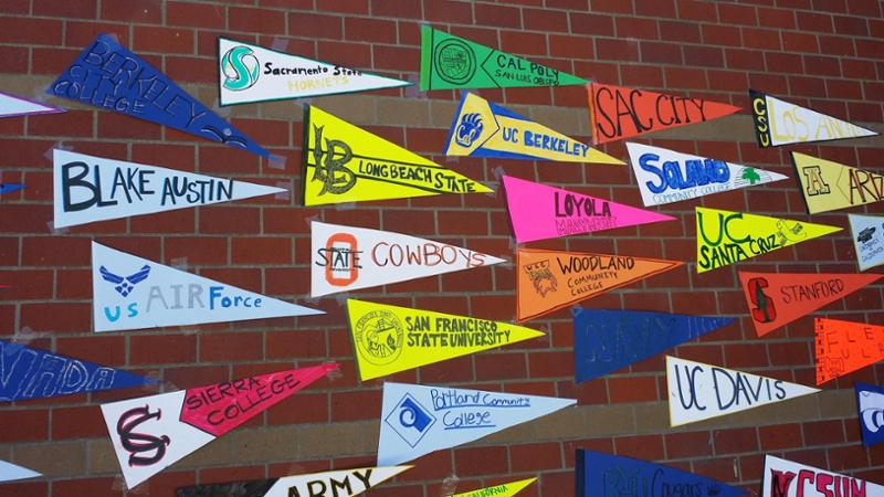 College Banners On Brick Wall